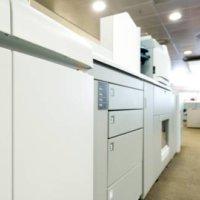 Printerfabrikant Océ haalt de broekriem aan